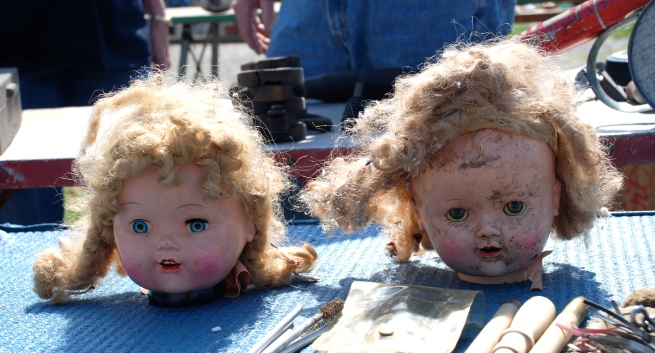 A couple of doll heads await a new home.