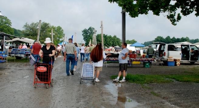 Rogers Flea Market has a slow start after an early morning rain.