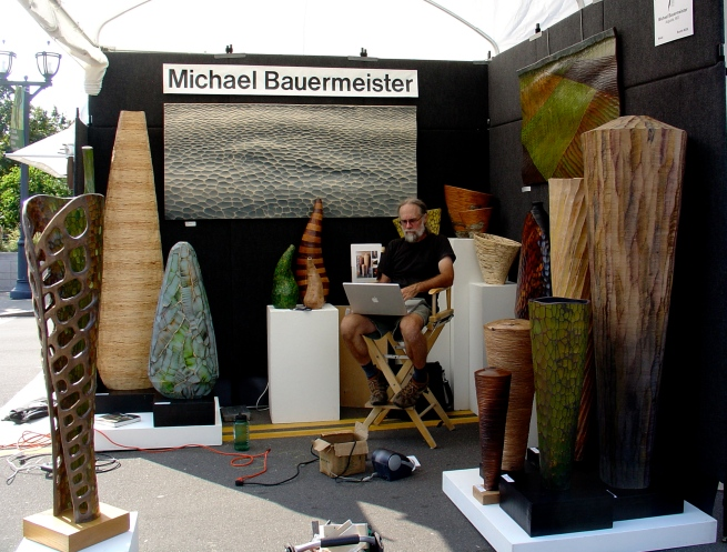 Michael Bauermeister and his sculptures before the opening of the festival.