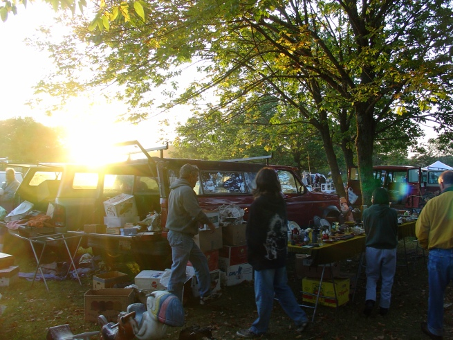 The morning sun comes up on the flea market early birds.