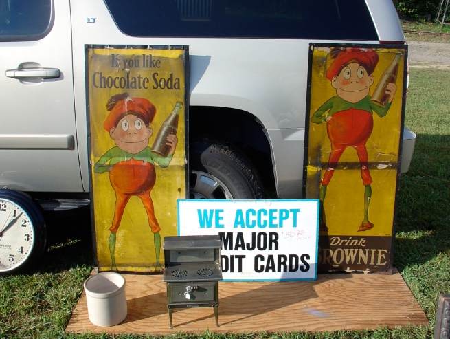 "Two ""incomplete"" Brownie Soda signs waiting to be adopted."