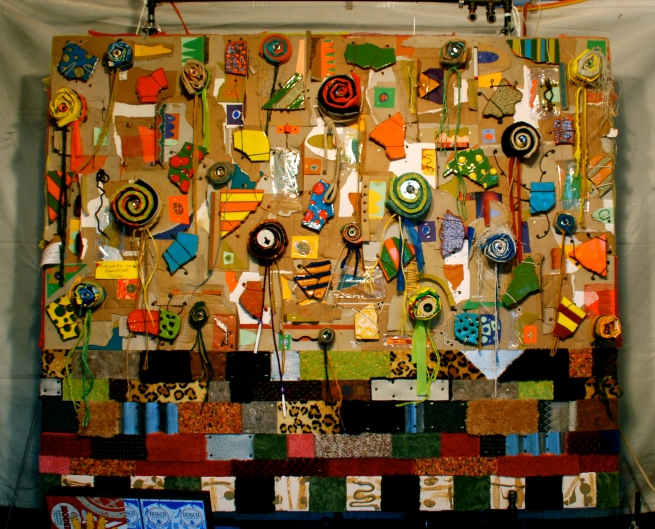 One of Kyle Hallam's large wall pieces made of a variety of recycled materials.