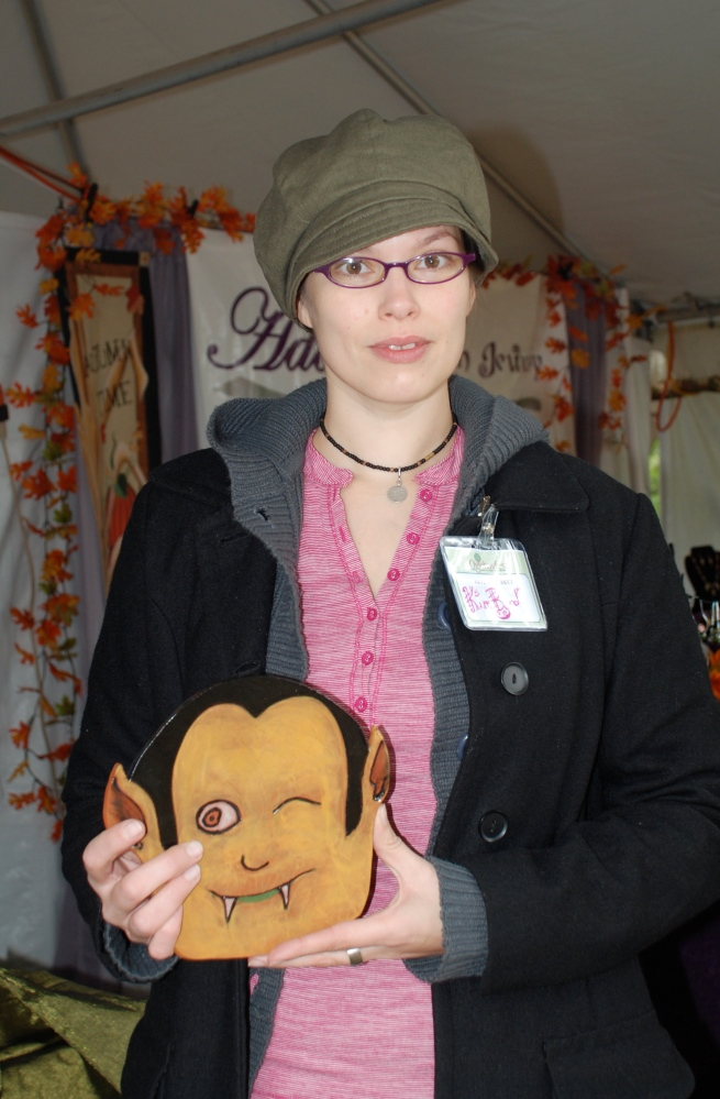 This is Kim, one of the new clay artists in the market, holding the Count Dracula I purchased from her.