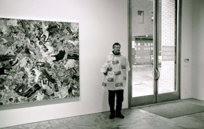 Padge, in a NYC gallery. wearing a Hershey rain poncho I loaned him.