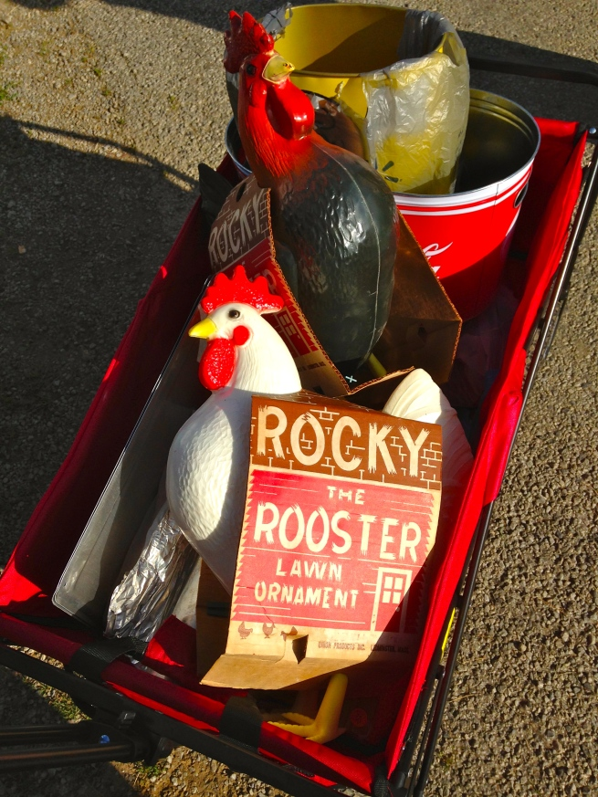 Two plastic Rocky-the-Roosters in my wagon! Ha!